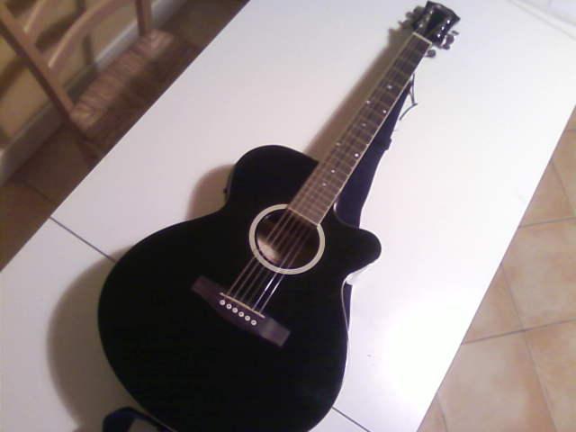 guitare folk noire petite annonce trocmusic. Black Bedroom Furniture Sets. Home Design Ideas